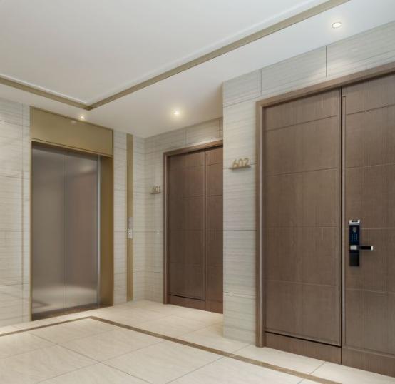 每一个标准层入户厅,都采用仿大理石瓷砖装修,配合拉丝古铜色的电梯